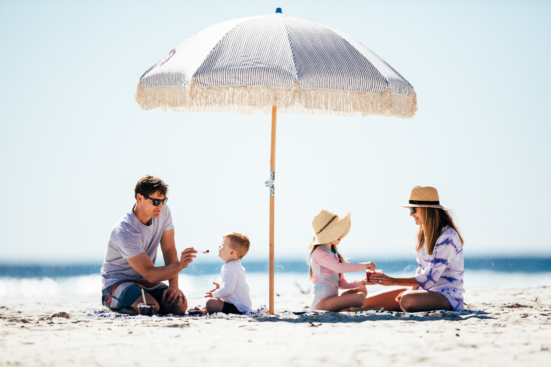 Family sitting on a sunny beach