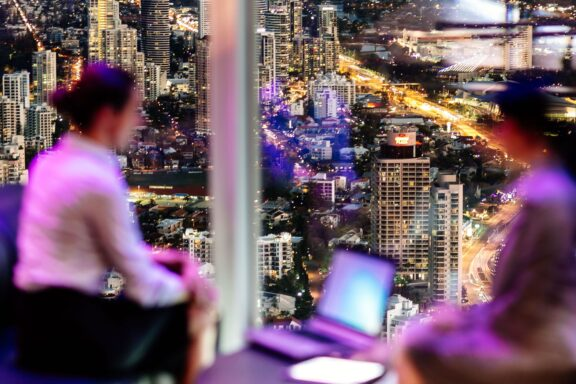 Casual Business meeting with Gold Coast City at night from high building