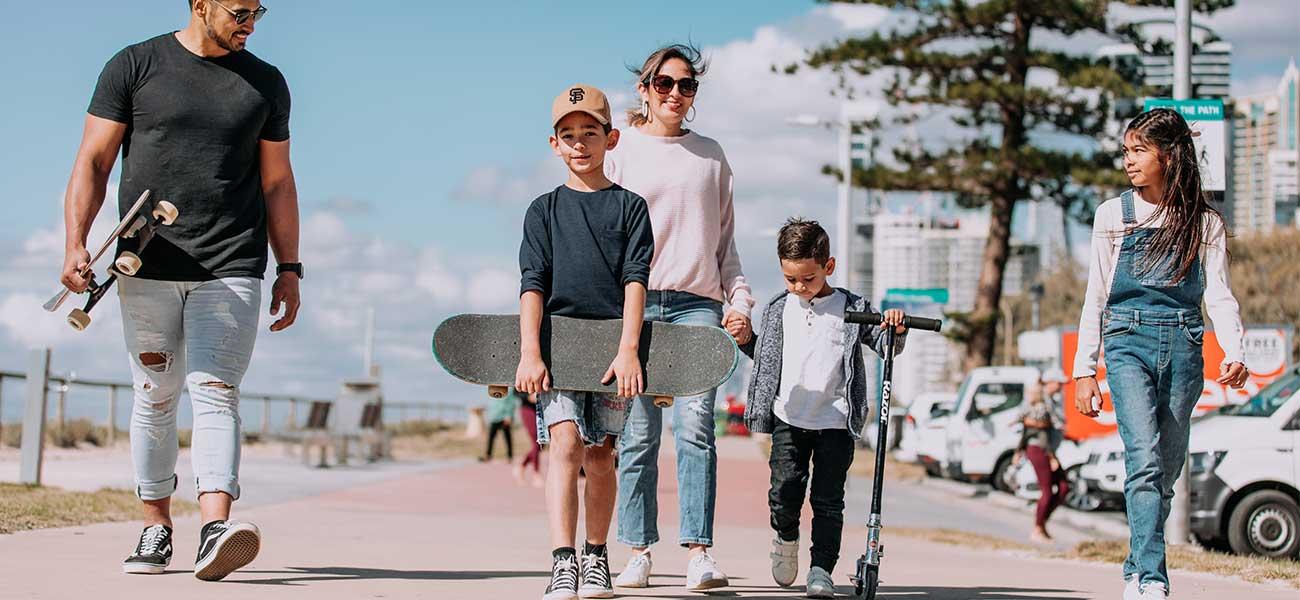 A family walking along the Gold Coast esplanade