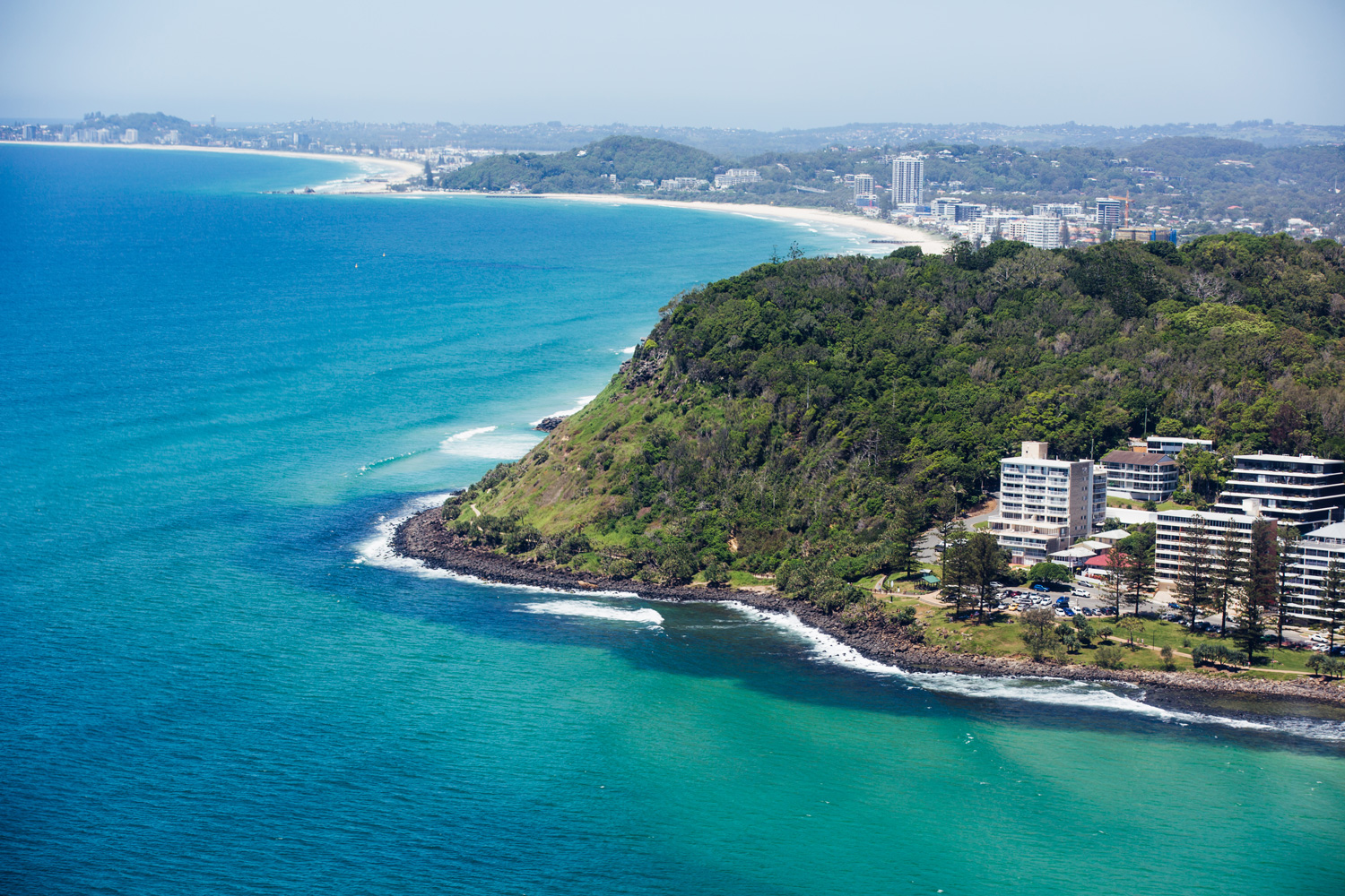 a scenic shot of Burleigh heads with the ocean and the land