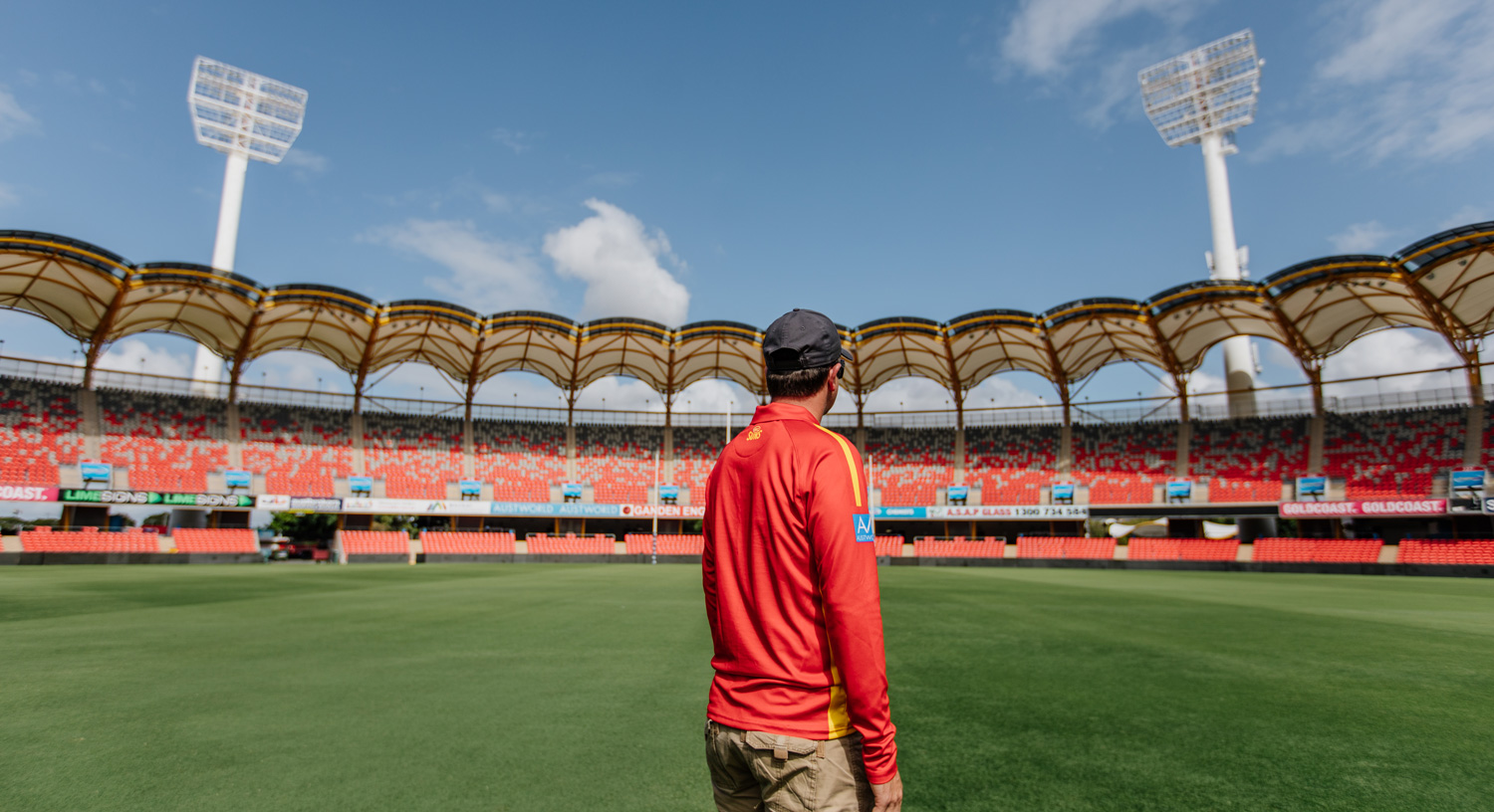 person standing at an empty stadium